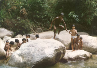 Temuan kids on the Luit River